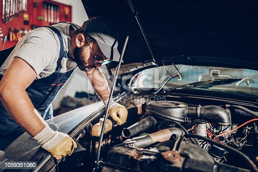 Man working on repair of old timer. 1973 date of manufacture