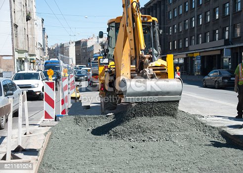 istock Repair of an asphalt covering on the brisk city street. 821161024