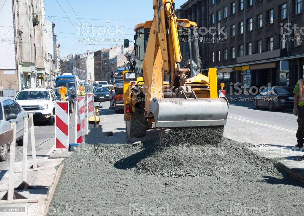 Repair of an asphalt covering on the brisk city street. stock photo