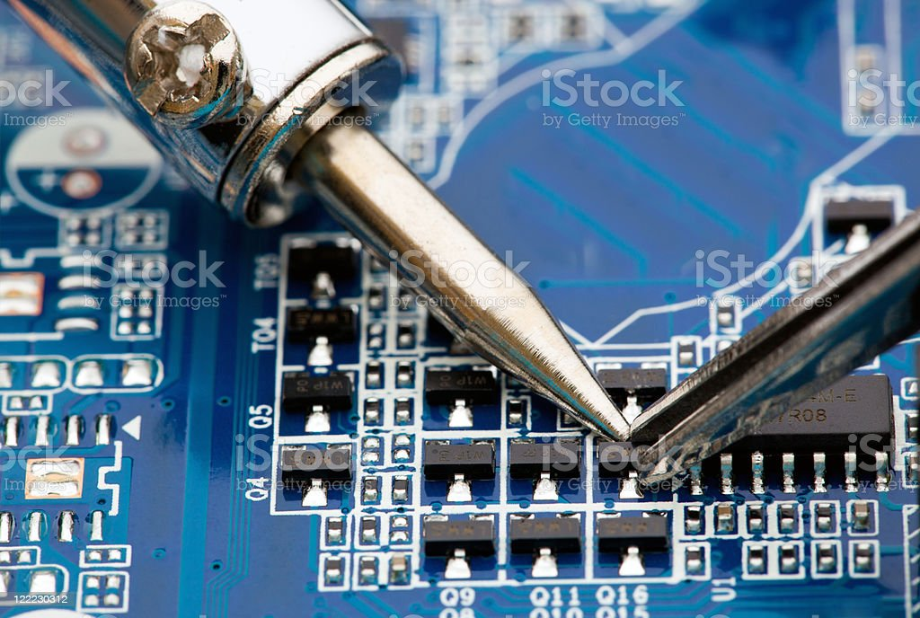 Repair of electronic components stock photo