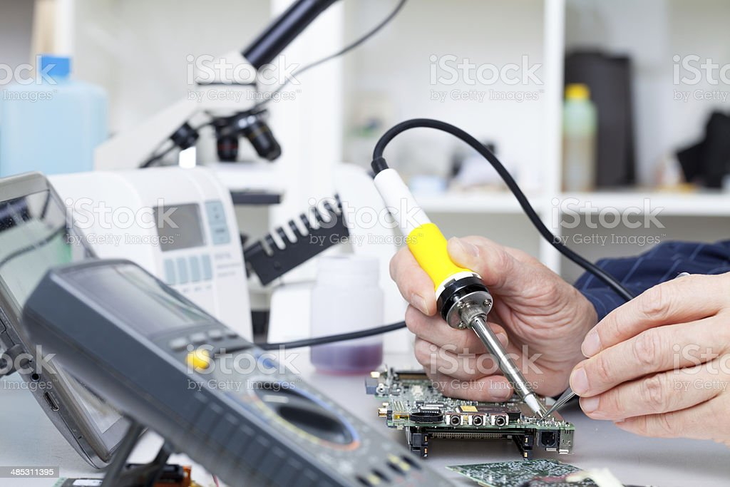repair of electronic devices, soldering parts stock photo