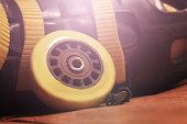 Repair of roller skates, yellow wheel