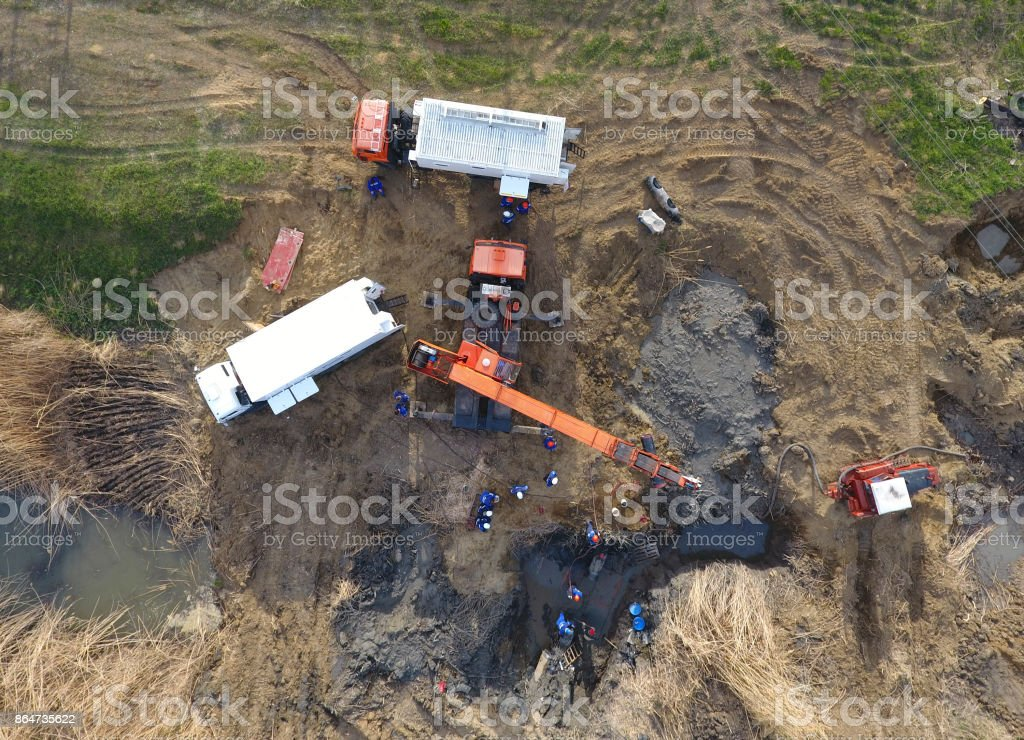 Repair of the gas pipeline section passing through the water channel. Repair work stock photo