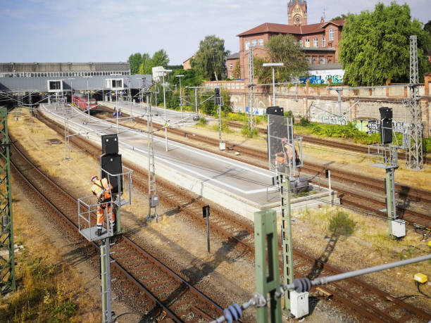 E050 Repair of the overhead line at the main station in Lübeck, Germany stock photo