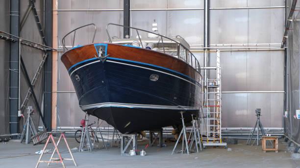 Repair of wooden boats in dry-dock Repair of wooden boats in dry-dock hull stock pictures, royalty-free photos & images
