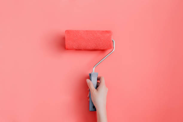 Repair painting the walls in a trendy living coral color Flip flops on pink background coral colored stock pictures, royalty-free photos & images