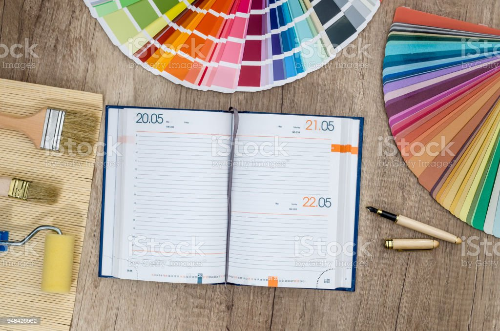 Repair plan with diary and colour swatches stock photo