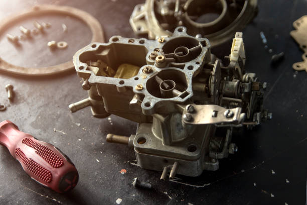 Repair process of machine parts with special tools Repair process of machine parts with special tools carburetor stock pictures, royalty-free photos & images