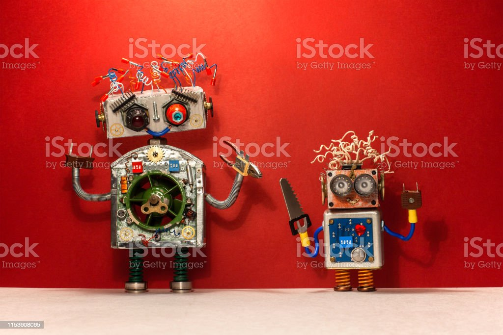 Repair service concept. Robots with handyman diy tools. Two funny...
