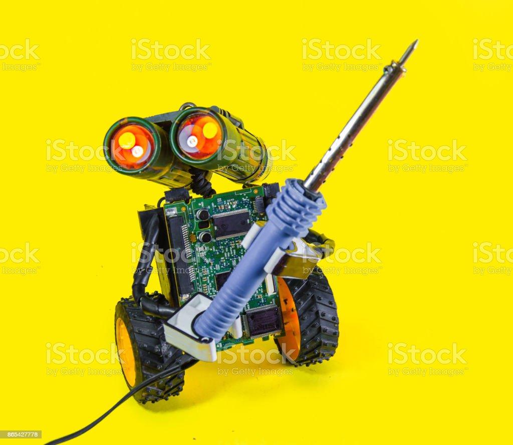 Repair serviceman robot. Cyborg toy camera lens eyes head, electric...