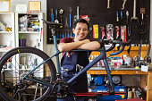 istock Repair technician bicycles was repaired gear bike shop.He is smiling 1288939805