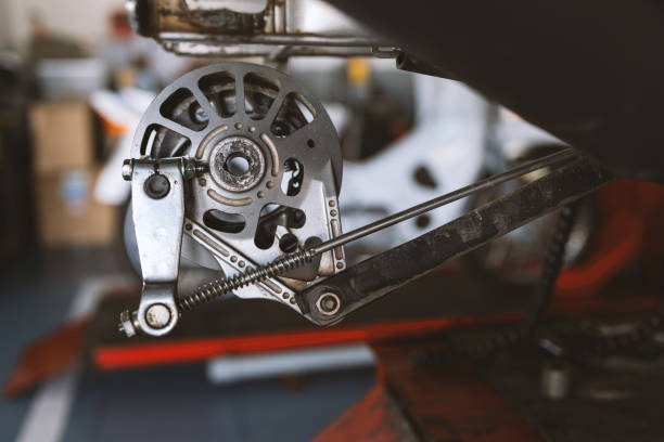 repair the disc brakes on the back of the motorcycle. soft-focus and  over light in the background – zdjęcie