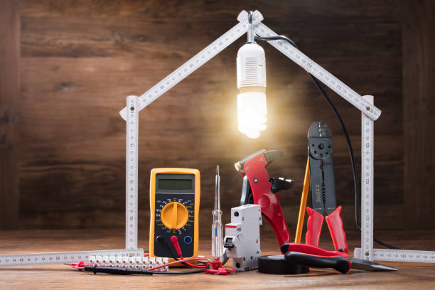 Repair Tools Under The Illuminated House stock photo