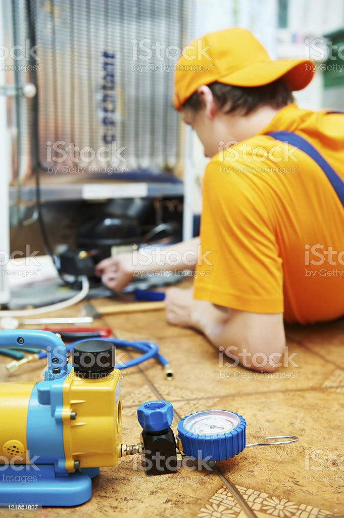 repair work on fridge appliance royalty-free stock photo