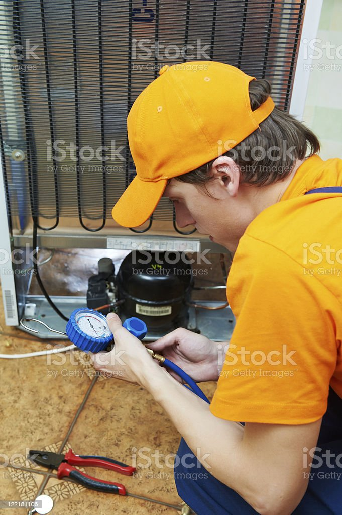 repair work on fridge appliance royalty-free stock photo