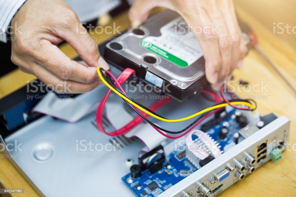 Repair,CCTV,Digital video recorder stock photo
