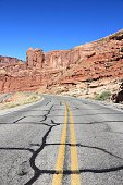 Road surface cracks fixed with a sealant. Arches Scenic Drive at Arches National Park, Utah.