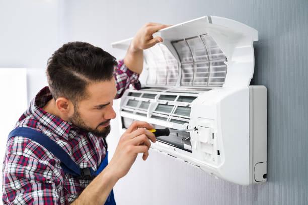 naprawa klimatyzatora naprawczego - naprawiać zdjęcia i obrazy z banku zdjęć