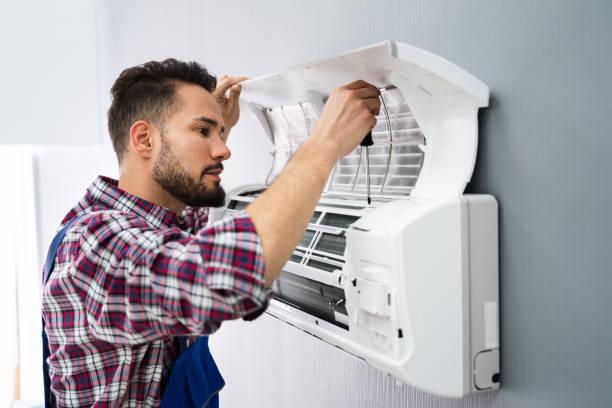 Repairer Repairing Air Conditioner stock photo
