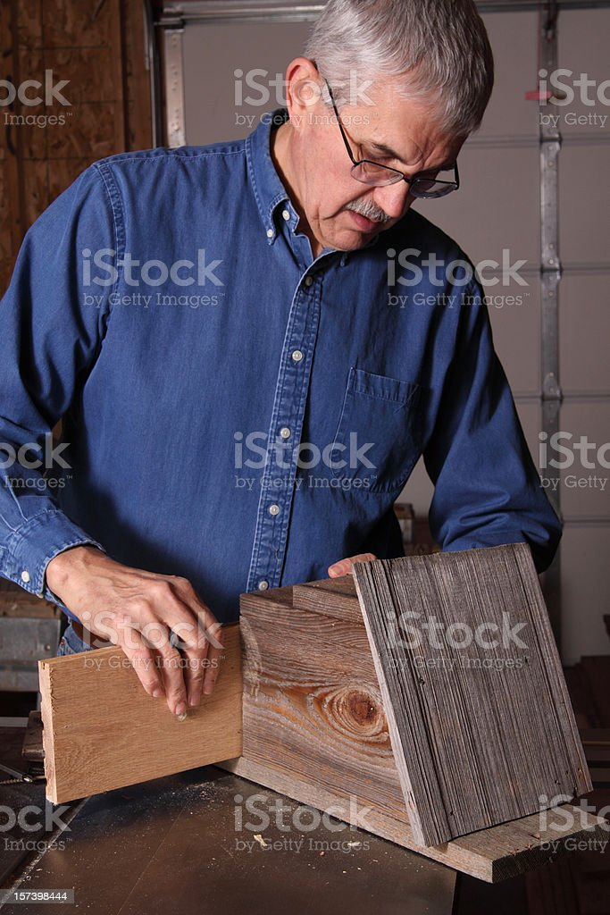 Repairing a Birdhouse royalty-free stock photo