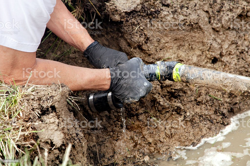 Repairing a Broken Pipe stock photo