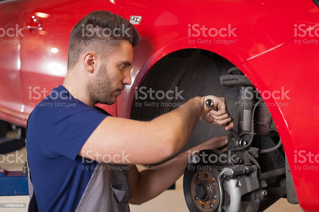 Repairing a car suspension stock photo