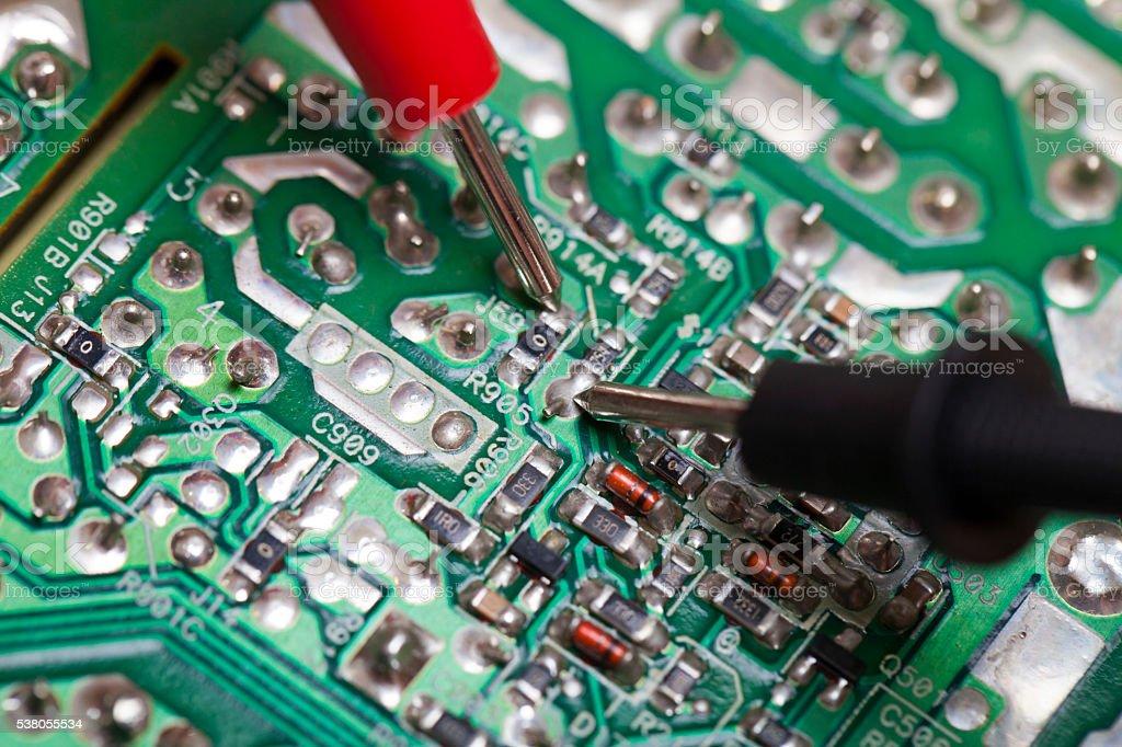 Repairing a circuit board stock photo