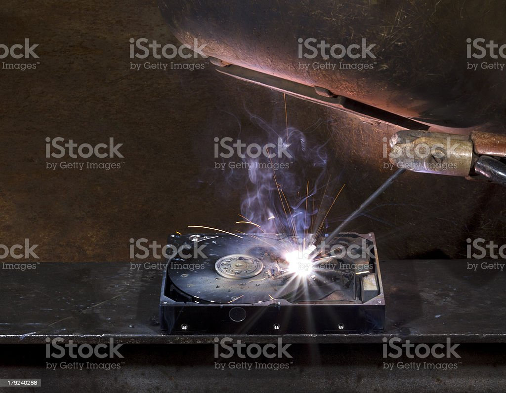 repairing a defect hard disk with welding apparatus stock photo