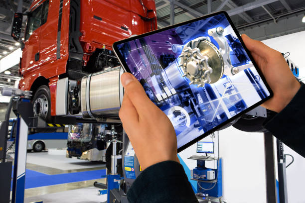repairing a truck using augmented reality application. - augmented reality stock photos and pictures