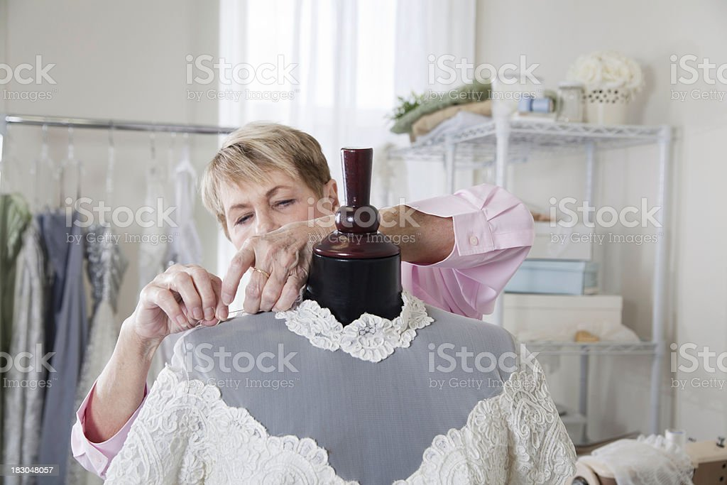 Repairing a Wedding Gown stock photo