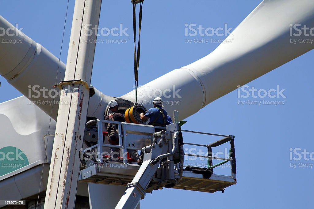 Repairing a wind turbine royalty-free stock photo