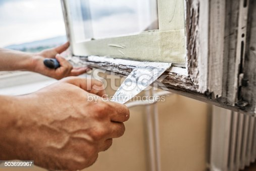 966792200 istock photo Repairing a window frame 503699967