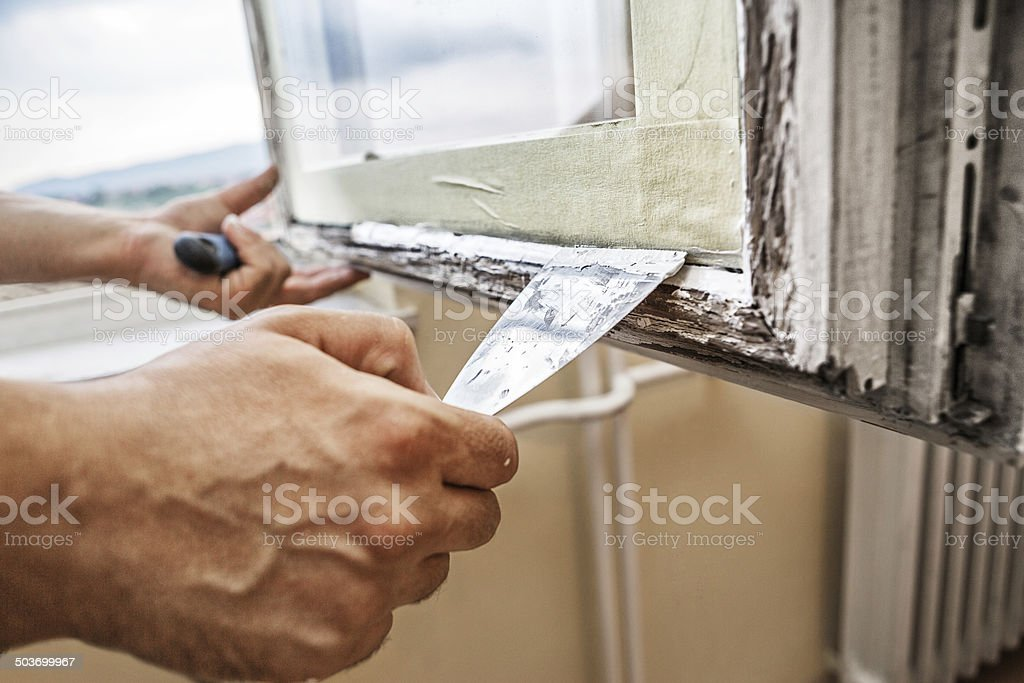 Repairing a window frame stock photo