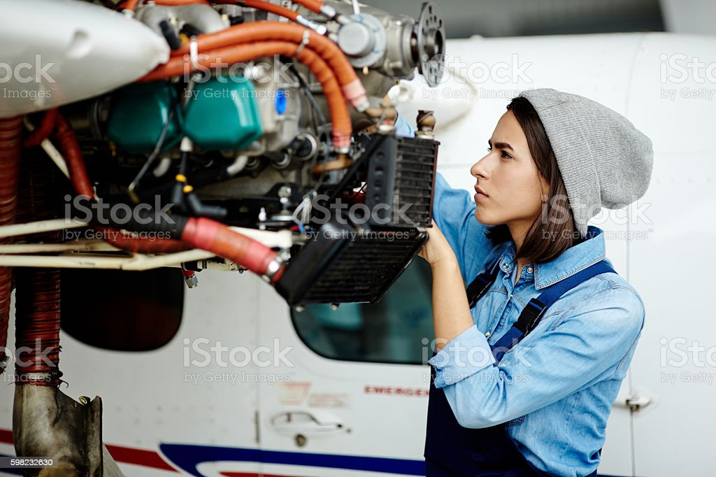 Repairing airplane motor stock photo