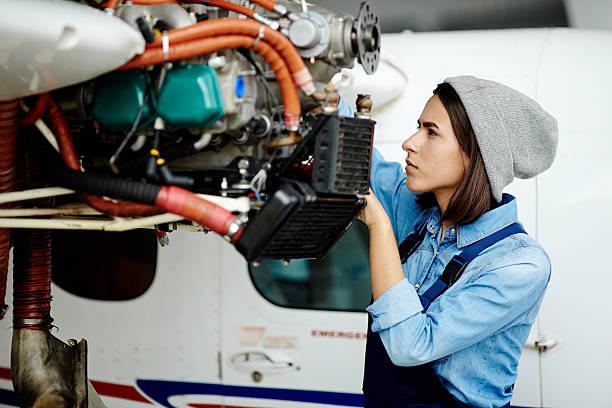 Repairing airplane motor stock photo