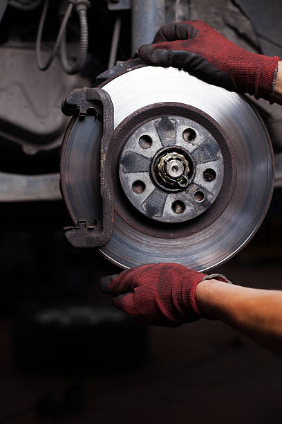 repairing brakes on car - brake service stock photos and pictures