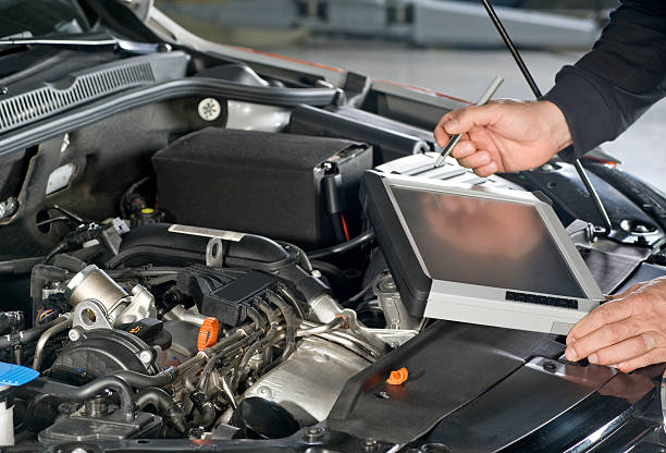 Repairing Car with computer stock photo