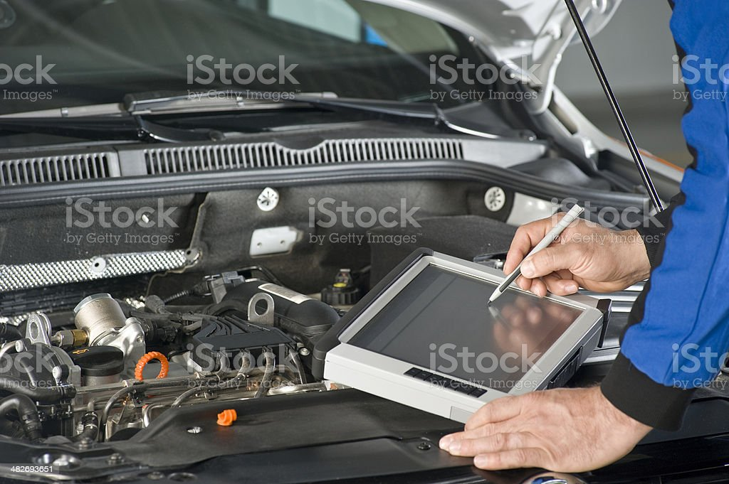 Repairing Car with computer royalty-free stock photo