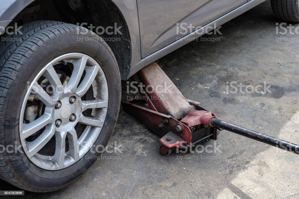 Repairing car with lifting up in shop stock photo