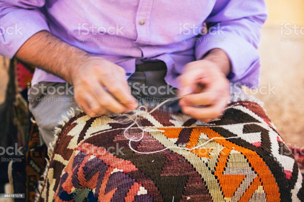 Repairing Carpet royalty-free stock photo