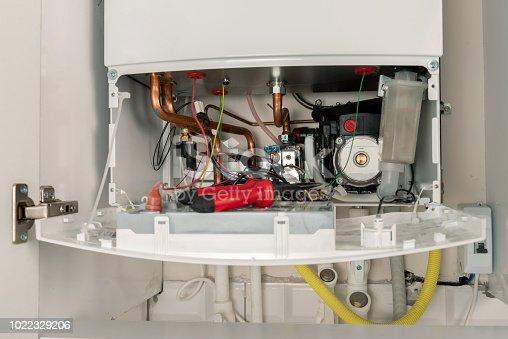 istock Repairing combi Gas Boiler 1022329206