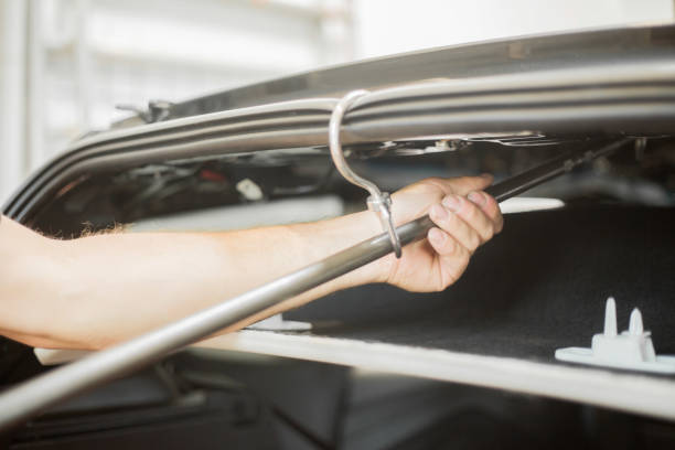 Repairing dents in a car stock photo