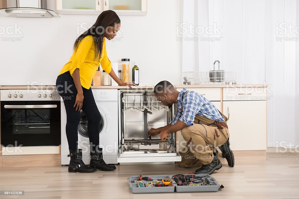 Repairing Dishwasher In Kitchen stock photo