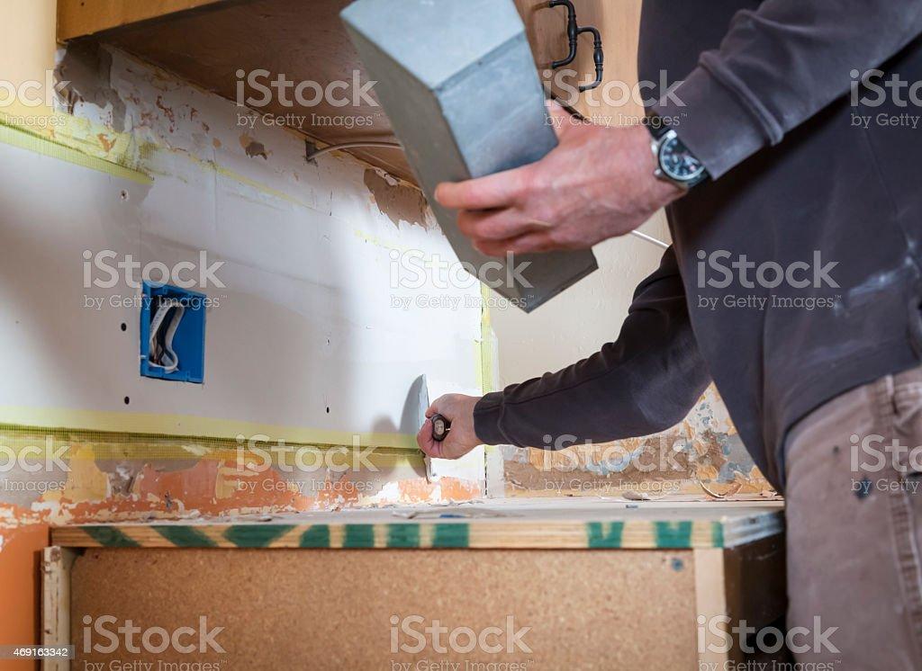 Repairing drywall stock photo