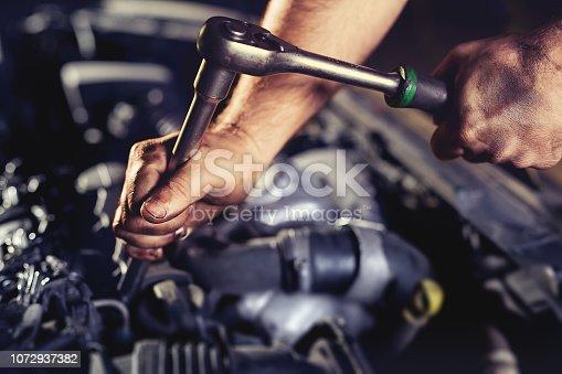 Repairing engine in auto repair shop