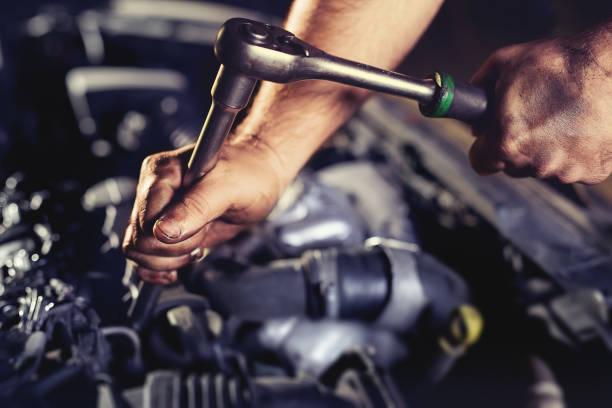 Repairing engine in auto repair shop Repairing engine in auto repair shop diesel stock pictures, royalty-free photos & images