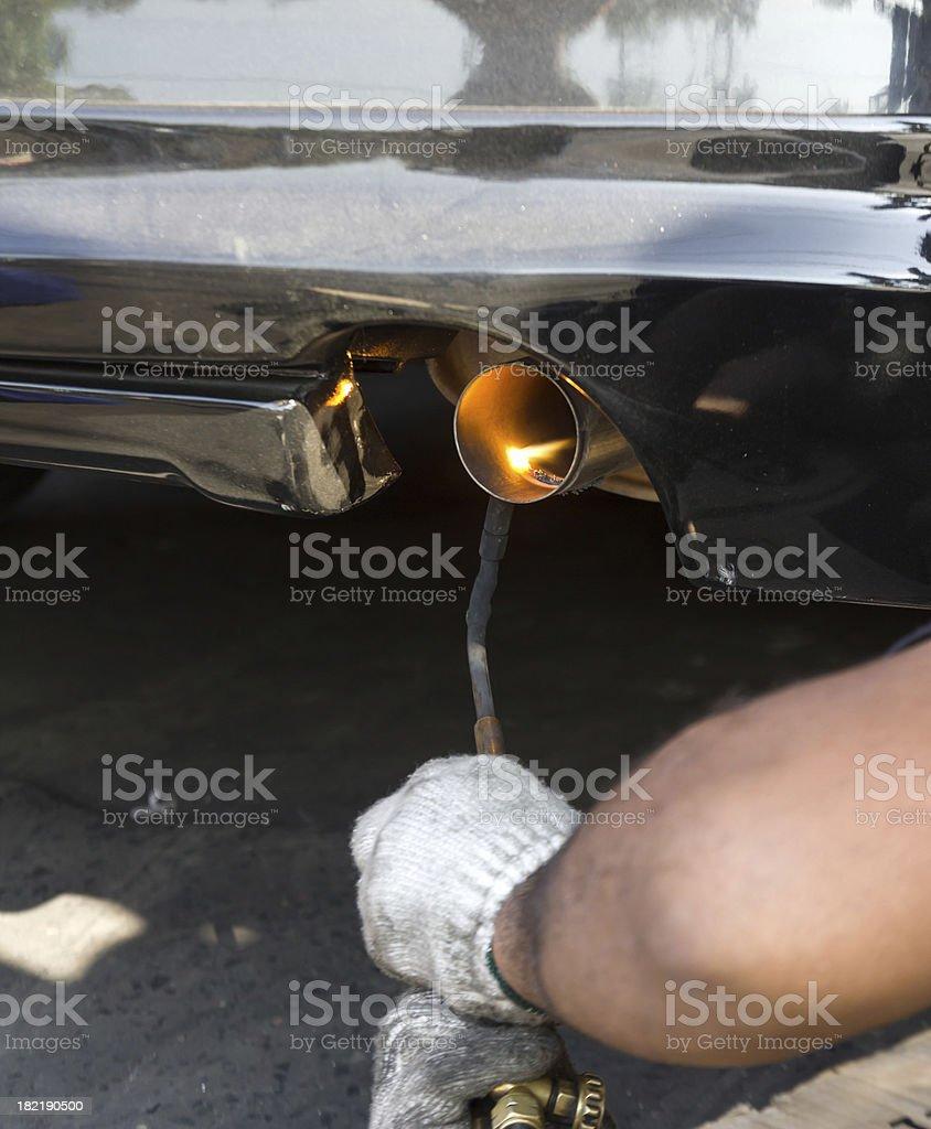 Repairing exhaust pipe royalty-free stock photo