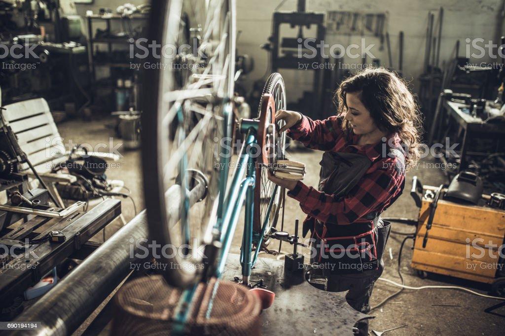 Repairing her bike stock photo