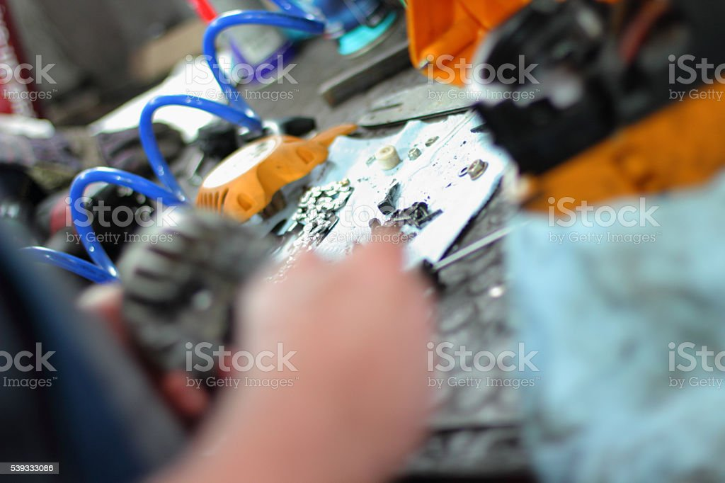 Repairing lawn mower engine stock photo