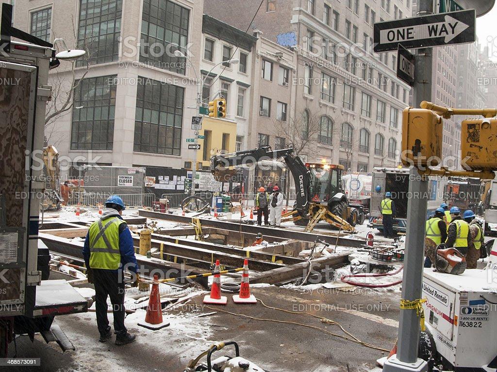 repairing New York water main break stock photo